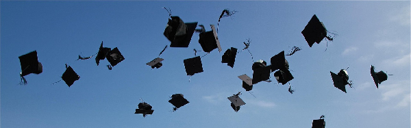grad caps thrown in the air